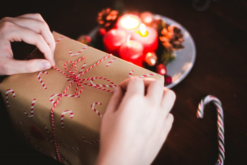 Wrapping a gift by candlelight.
