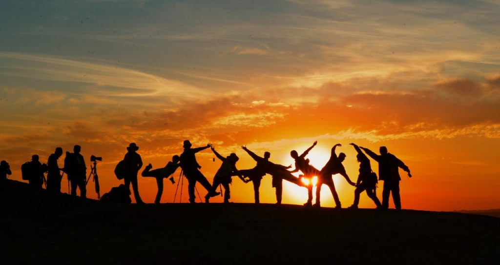 Group silhouette at sunset