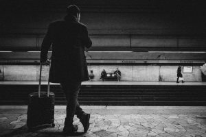 man waiting at train station
