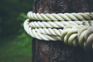 Rope knotted tightly with no loose ends.