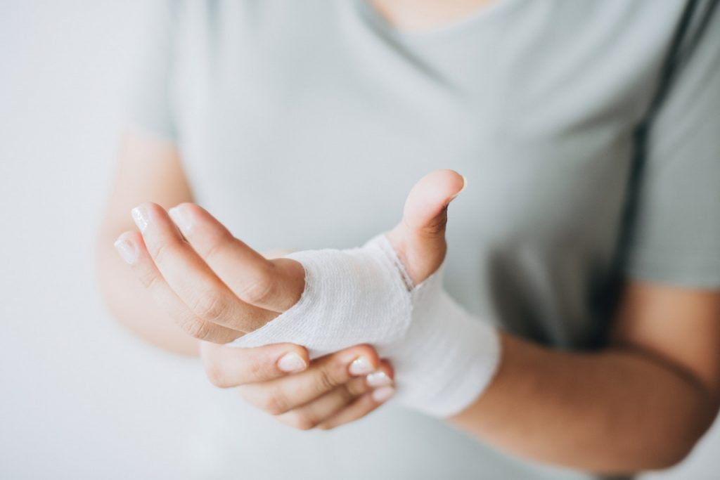 Holding a bandaged hand. #ExquisiteSelfCare #LoveYourself #BecauseYouMatter #You'reWorthIt