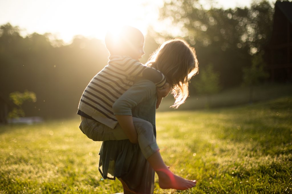 Giving a child a piggy-back ride. #ExquisiteSelfCare #LoveYourself #BecauseYouMatter #You'reWorthIt